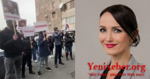 Erməni deputatın anası etirazçıların üzərinə qaynar su atdı -